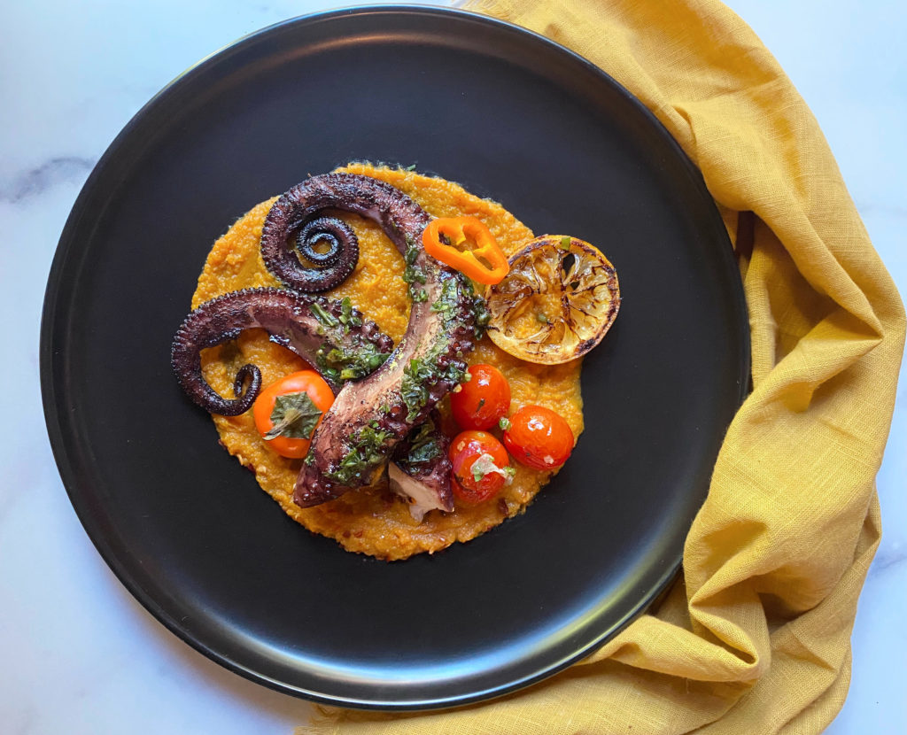 Grilled octopus with pumpkin, tomato and basil dressing